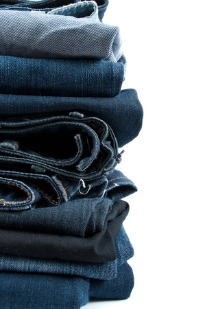 Jeans pile isolated on white Stock Photo