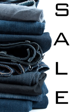 Jeans pile isolated on white photo