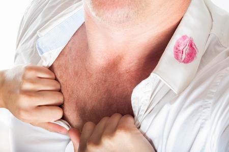 unfaithfulness: red lipstick on a shirt on a mens shirt