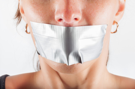 abducted: abducted woman with sealed mouth Stock Photo