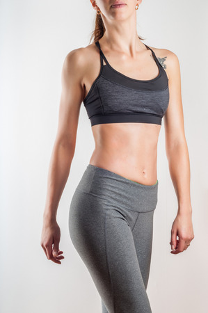 Fit woman body in sportswear on white background Stock Photo