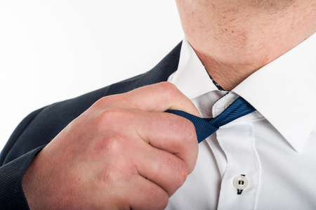 loosen: Man is loosening a tie after hard work Stock Photo