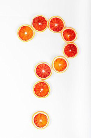Question mark made from citrus fruit blood oranges on white background