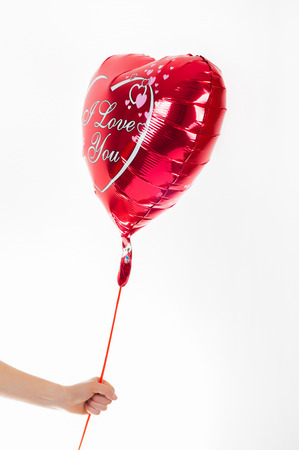 Valentines day, birthday, love concept. Red heart shaped balloon with words I love you on white background