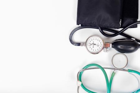 preasure: Health care concept - blood preasure cuff, monitor and stethoscope on white background