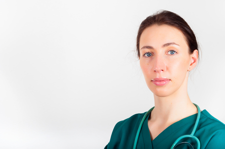 Portrait of young attractive doctor, surgeon, nurse with stethoscope Stock Photo