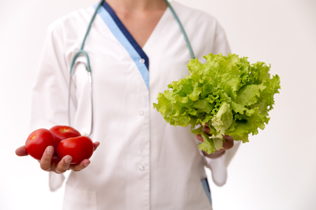 dietetics: Vegetable diet nutrition and medication concept. Nutritionist offers healthy vegetables diet.
