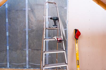 Attic renovation. Installation of drywall