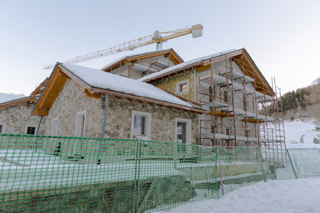 Construction of hotel or tourist apartment at ski resort in Italy, Alps