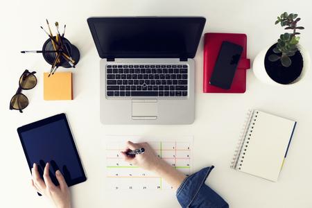 Calendar planner agenda schedule concept. Woman working in her office, planning. Freelance, graphic designer Stock Photo