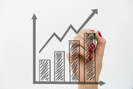 woman s hand drawing a graph growth and business concept stock