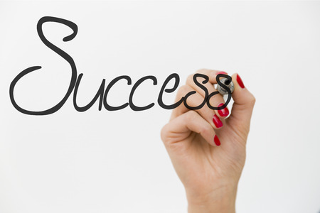 woman s hand drawing the word success isolated on white background