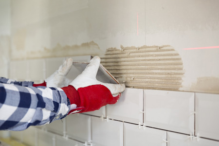 Process of tiling the tiles in the kitchen. Home improvement, renovation concept Stock fotó