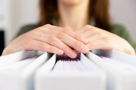 Womans hands holding accounting folders. Accounting, finance, paper work concept. Stock Photo