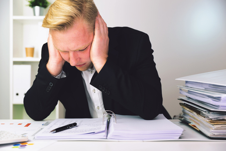 Businessman in a dark blue suit calculating sales results. Finance accounting concept