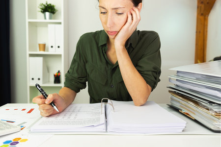 Businesswomen sitting on a table and calculating sales results. Business finance concept. Stock Photo