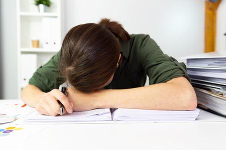 Businesswomen overworked in office. Business finance concept.