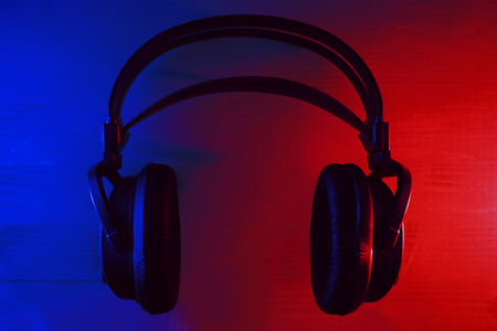 Headphones with neon blue and red lights on a dark background Stock Photo