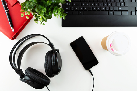 Headphones and office tools on a white background. E-learning concept.