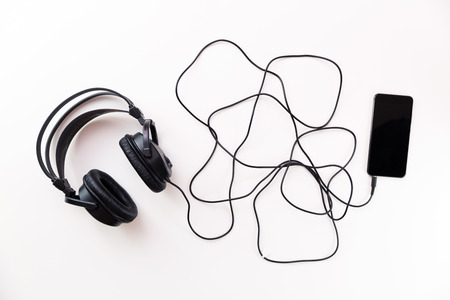 Headphones with a long wire connected to smartphone
