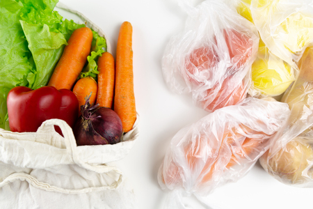 Zero waste concept. Vegetables in a woven bag. Woven bag vs plastic bags.