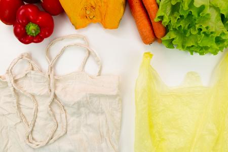Zero waste concept. Woven bag vs plastic bags. Stock Photo
