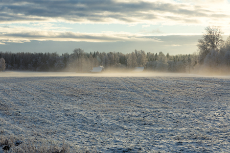Old country house in a misty cold winter morning