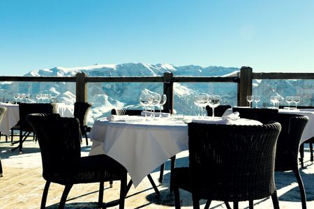 Alpine outdoor restaurant at ski resort in Alps, France