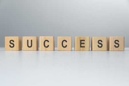 Success word from wooden blocks on desk. Business success