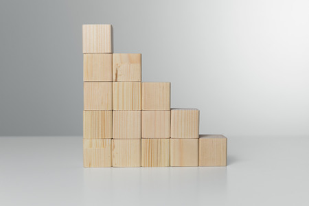 Concept of growth in business,stack of wooden block