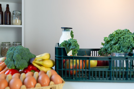 Fresh healthy groceries and vegetables from supermarket in green tray box. Food delivery service