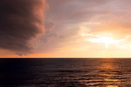 Dramatic sunset scene in the sea. Sea and sky sunset landscape