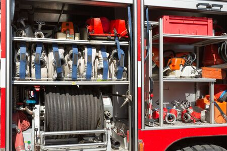 Part of equipment of a firetruck: hoses and syringe of a water cannon Banque d'images - 129627343