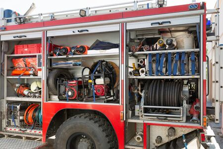 Part of equipment of a firetruck: hoses and syringe of a water cannon Banque d'images - 129627344