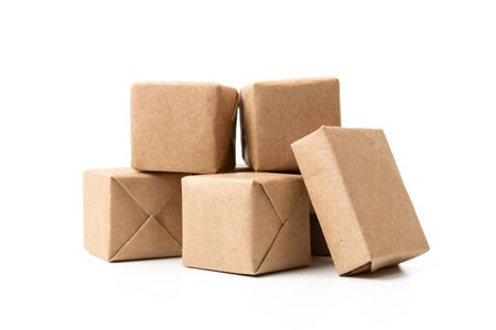 Online shopping and delivery concept. Bunch of express delivery carton boxes. Mini cardboard boxes. Parcel boxes with craft paper.