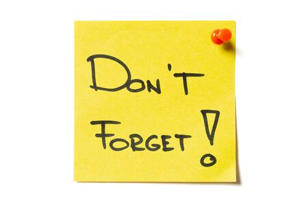Sticky note message on yellow sticky note pinned to white background