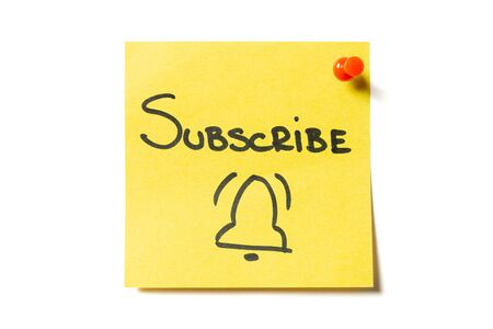 Subscribe and bell drawn on yellow sticky note. Online registration Stock Photo
