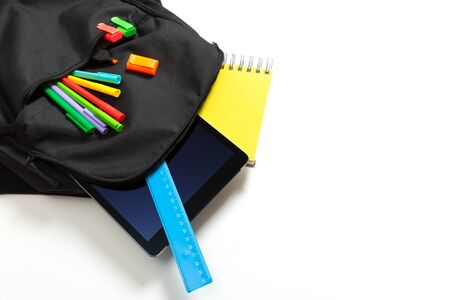 Back to school concept. Backpack with school supplies and tablet