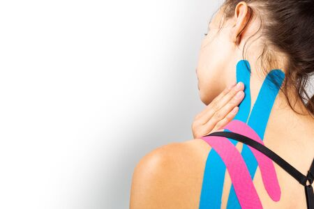 Kinesiotaping, kinesiology. Female athlete with kinesiotape, muscle tape on shoulder Stockfoto