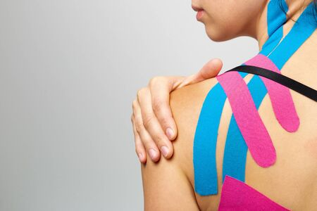 Kinesiotaping, kinesiology. Female athlete with kinesiotape, muscle tape on shoulder Stok Fotoğraf