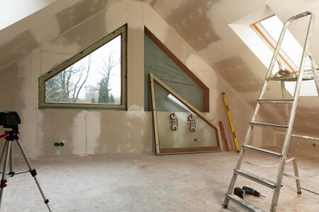 PVC window instalation in a new insulated and filled dry wall attic.