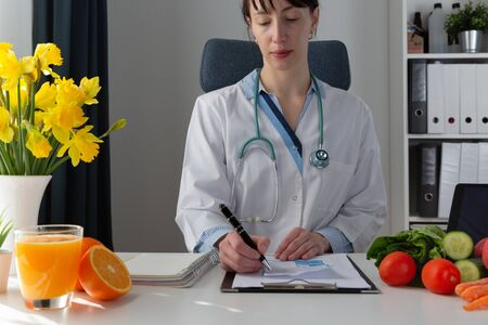 Vegetable diet nutrition and medication concept. Nutritionist offers healthy vegetables diet. In a natural light