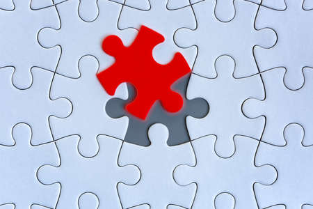 White jigsaw puzzle pieces on gray background