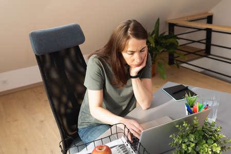 Top view of women working on laptop in attic in home office. A new normal work concept. Stockfoto