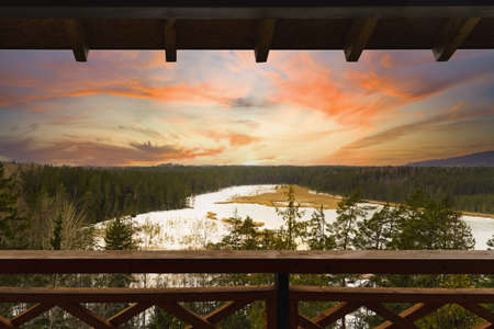 View from watchtower in a park, white beautiful sunset and frozen lake. Stockfoto