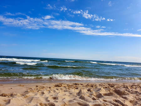 The Baltic Sea, gentle waves and blue sky