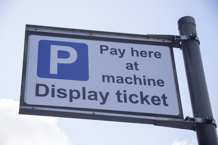 Pay here at machine display ticket road sign