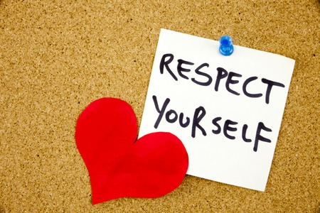 The phrase Respect Yourself in red text on a lined index card pinned to a cork notice board as reminder Stock Photo