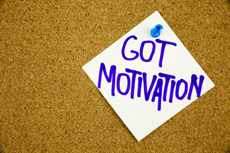 pendrive: A yellow sticky note writing, caption, inscription Motivational concept - got motivation question - handwriting Stock Photo