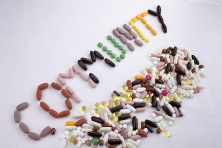 Conceptual Hand writing text caption inspiration Medical care Health concept written with pills drugs capsule word community On white isolated background with space Stock Photo